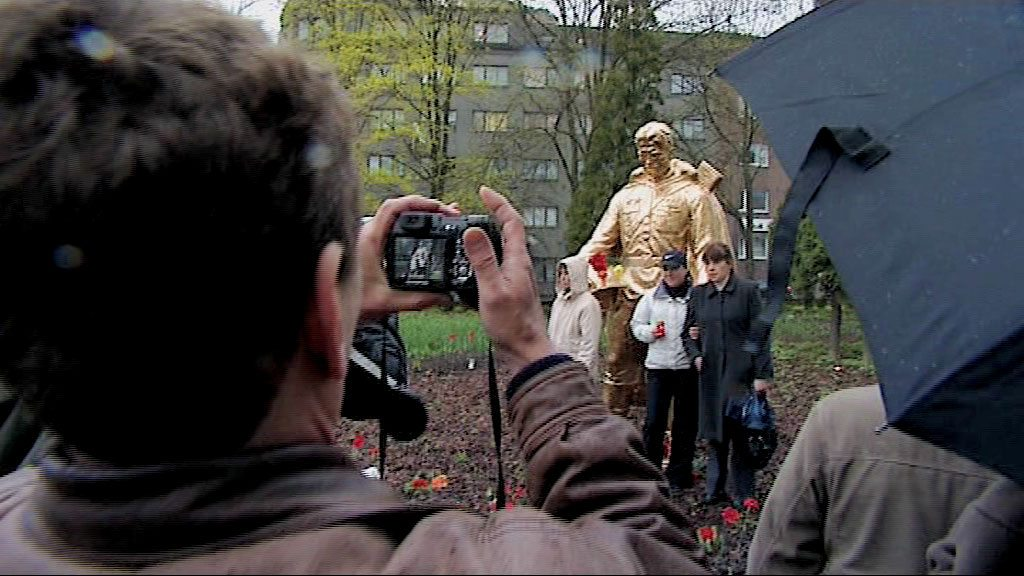 Fig 2 Still from video of Kristina Norman's intervention in public space 2009, Russian Estonians have their picture taken © Kristina Norman 2009