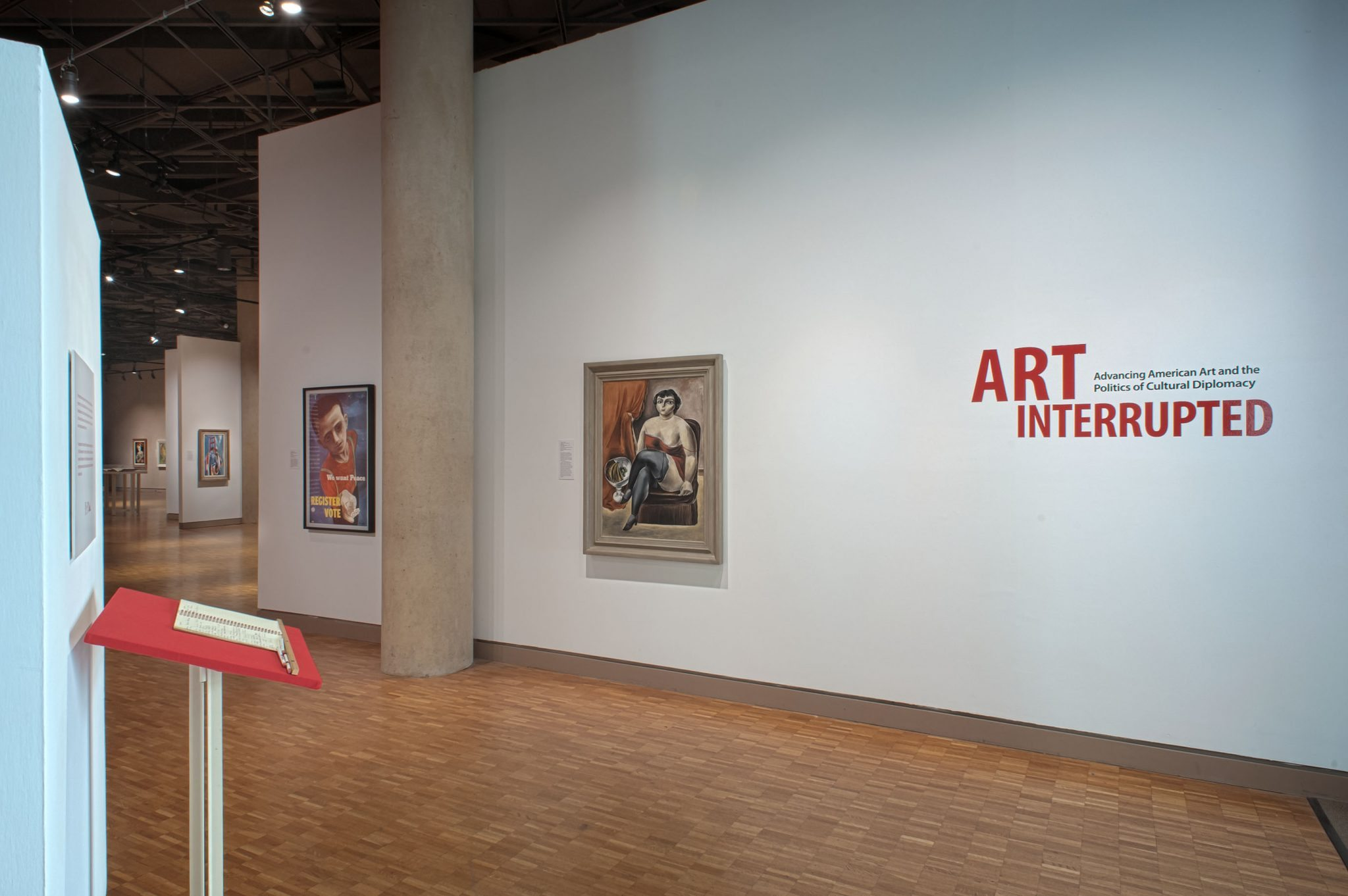 Fig 2. Installation view, Art Interrupted, Indiana University Art Museum, 2013. At left: Yasuo Kuniyoshi (American, born Japan, 1893‒1953), Circus Girl Resting, ca. 1925, oil on canvas, 99.7 x 73 cm, Jule Collins Smith Museum of Fine Art, Auburn University; Advancing American Art Collection 1948.1.22. Photograph by Kevin Montague.