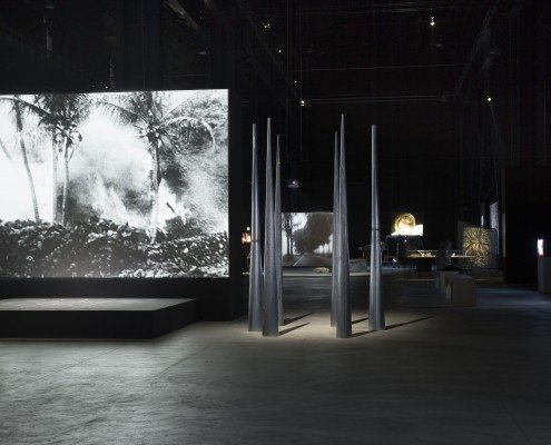 Figure 3: Mirage (1976/2005/2010), installation view showing Revolted by the Thought of Known Places…Sweeney Astray (1992/1994) in the distance. HangarBicocca, Milan, 2014.