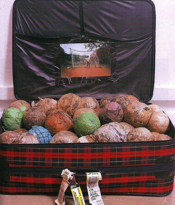 Fig. 1, Samson Kambalu, Goal Keeper (2000), suitcase, plastic balls, photograph.