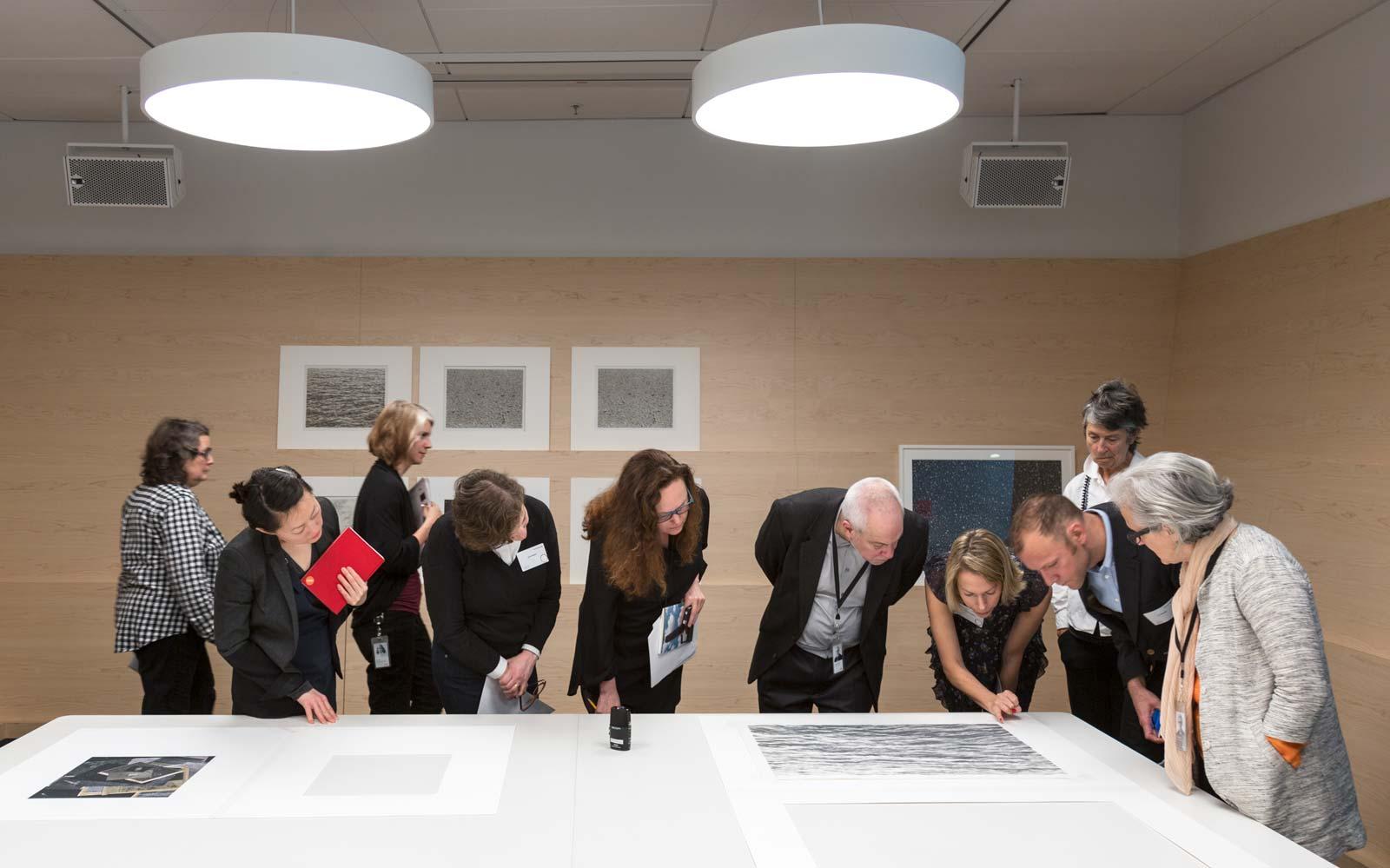 Figure 2. A cross-departmental team examines works on paper by artist Vija Celmins at SFMOMA in 2017.
